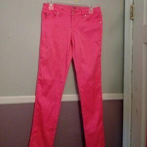 Neon pink skinny leg pants